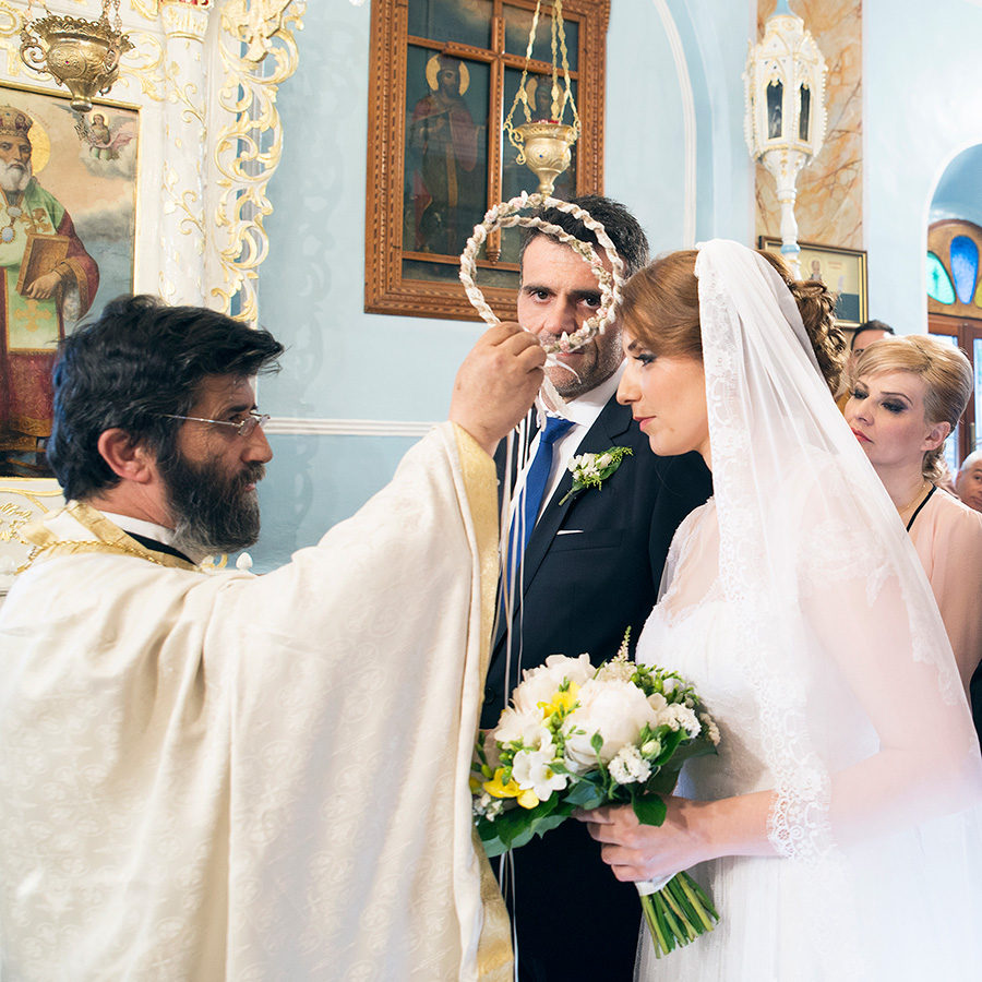 Greek wedding. stefana. Orthodox church. Bride and groom. Chios, Greece. Alepa Katerina . Layer Photography