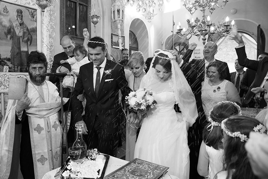 Greek wedding. Rice. Orthodox church. Isaias dance. Bride's and Groom's portrait. Chios, Greece. Alepa Katerina . Layer Photography
