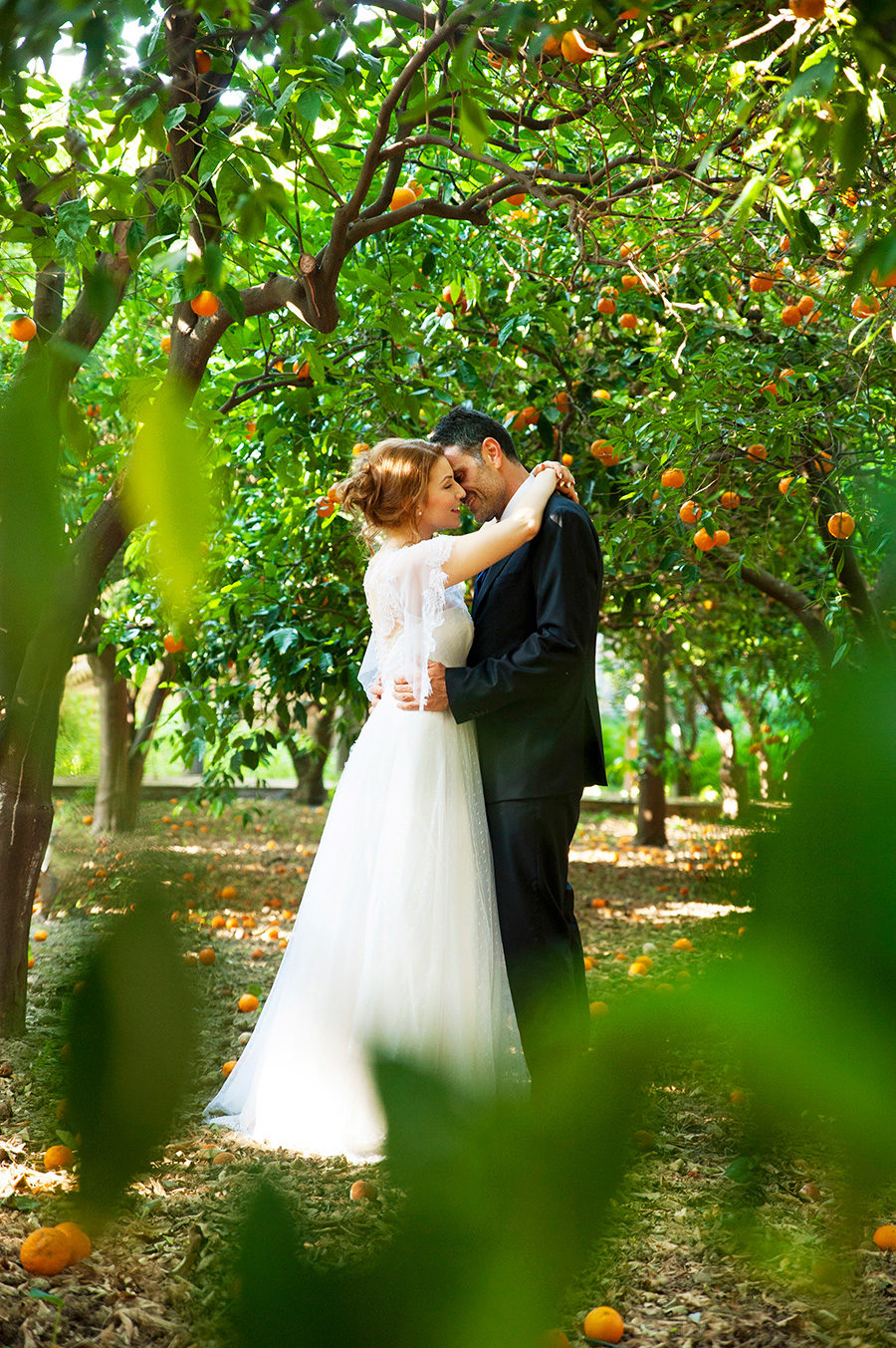Play with the oranges. Kampos. Wedding Photoshooting. orange trees. Bride's and Groom's portrait. Riziko. greek wedding . Chios , Greece. greek island. Couple photoshooting. Love and married. Alepa Katerina . Layer Photography