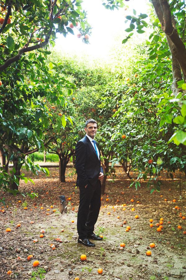 Wedding Photoshooting. orange trees. Groom's portrait. Riziko. greek wedding . Chios , Greece. greek island. Couple photoshooting. Love and married. Alepa Katerina . Layer Photography