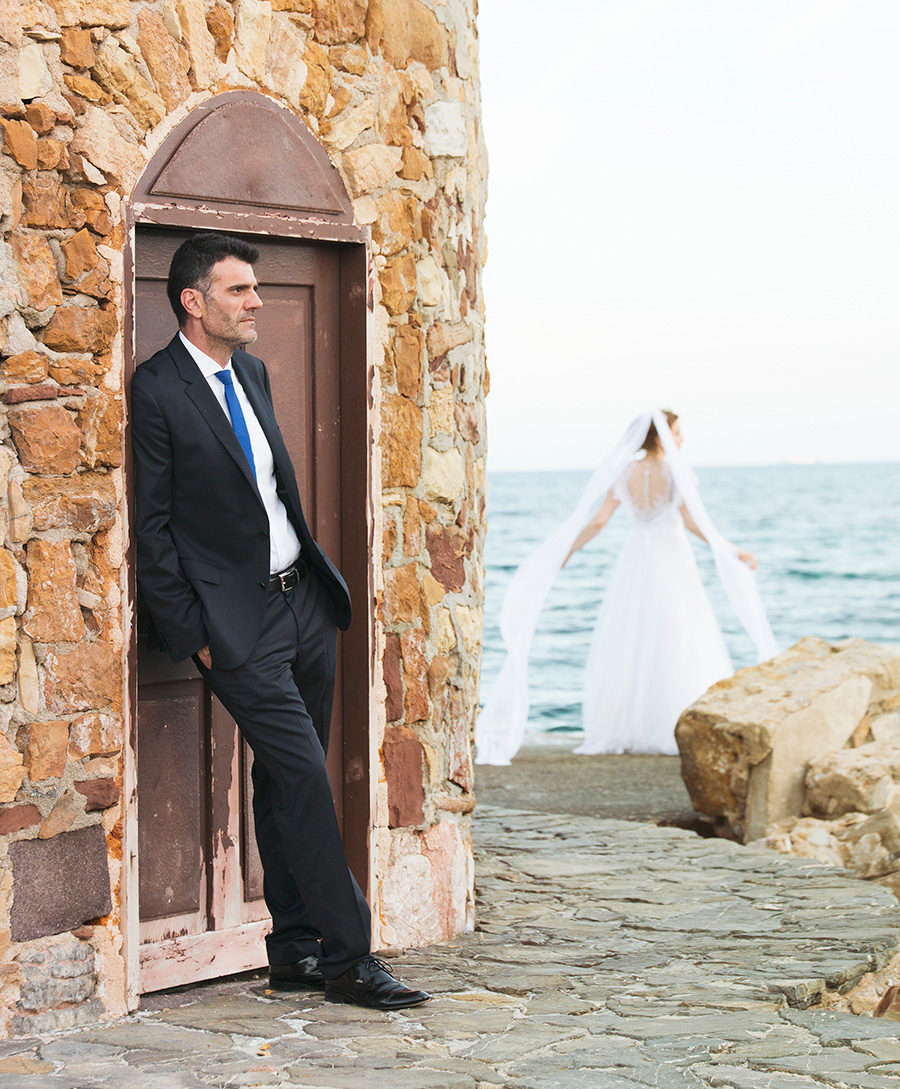 Wedding Photoshooting.Groom portrait. near the sea. greek wedding . Chios , Greece. greek island. Couple photoshooting. Love and married. Alepa Katerina . Layer Photography