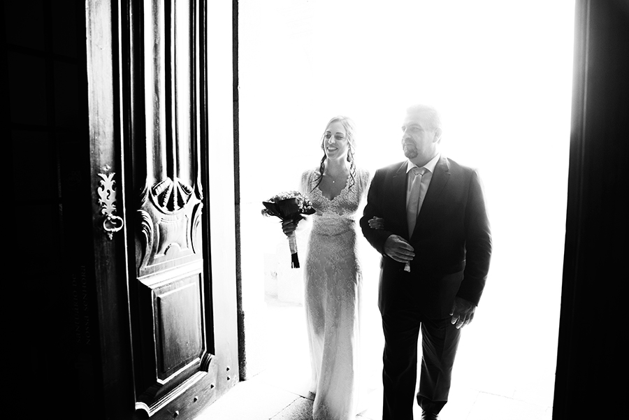 Bride with her father just arrived in the church. Santuário de Nossa Senhora dos Remédios, Shrine of Our Lady of Remedies the cathedral in Lamego.Portugal. Layer Photography. Alepa Katerina