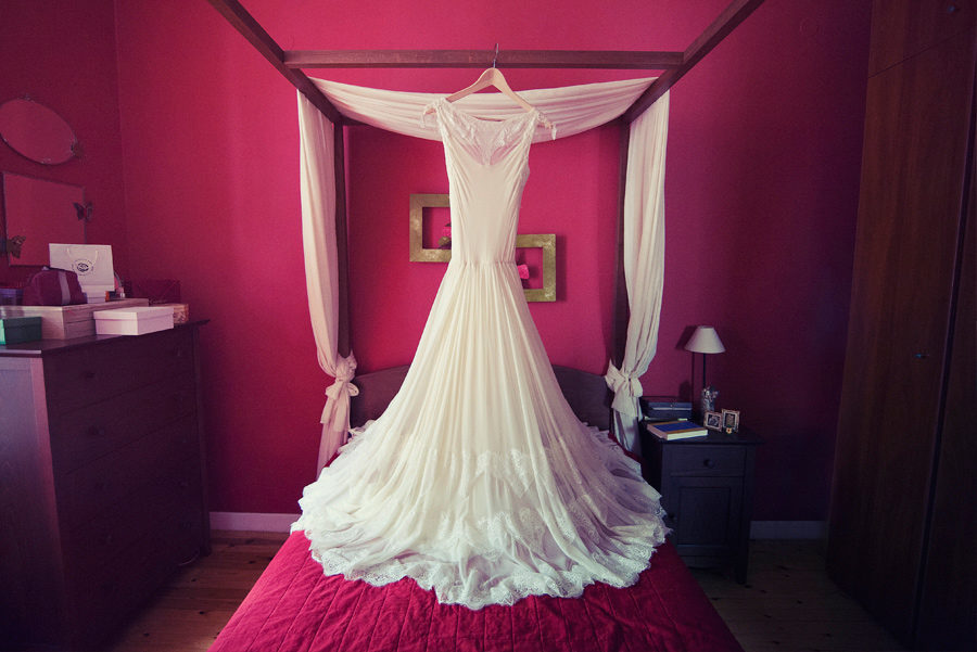 The wedding dress. Red for passion . Vintage . bedroom . Layer Photography. Alepa Katerina , Thessaloniki. Greece