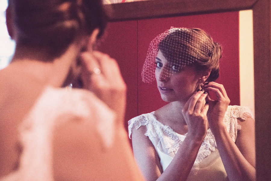 Bride's preparation. Bride wearing the earrings. small diamonds. vintage Bride.mirror. Civil wedding in Thessaloniki, Greece. Layer Photography. Alepa Katerina
