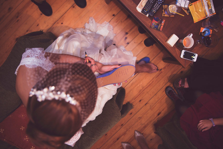 Bride's preparation. Write the names of the single ladies in the wedding shoes. Civil wedding in Thessaloniki, Greece