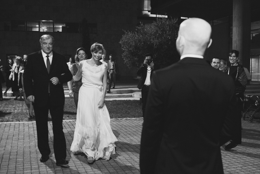 Town hall. Couple in love. Happy life, bride and groom. Bride just arrived with her father. Paparazzi. Happy friends. Civil wedding in Thessaloniki, Greece