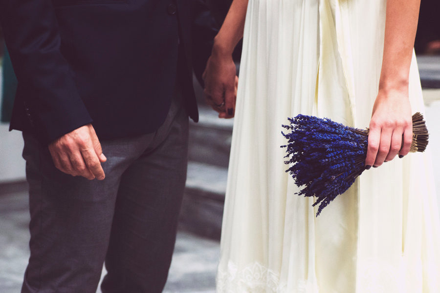Town hall. Couple in love. Happy life, bride and groom holding hands, close up portrait. Flowers. Wedding bouquet. Civil wedding in Thessaloniki, Greece