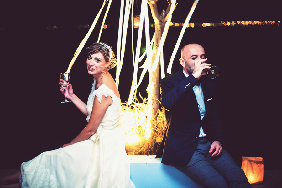 After the wedding the couple take a break in the wedding party drinking a glass of wine. Civil wedding in Thessaloniki,Greece. Layer Photography. Alepa Katerina