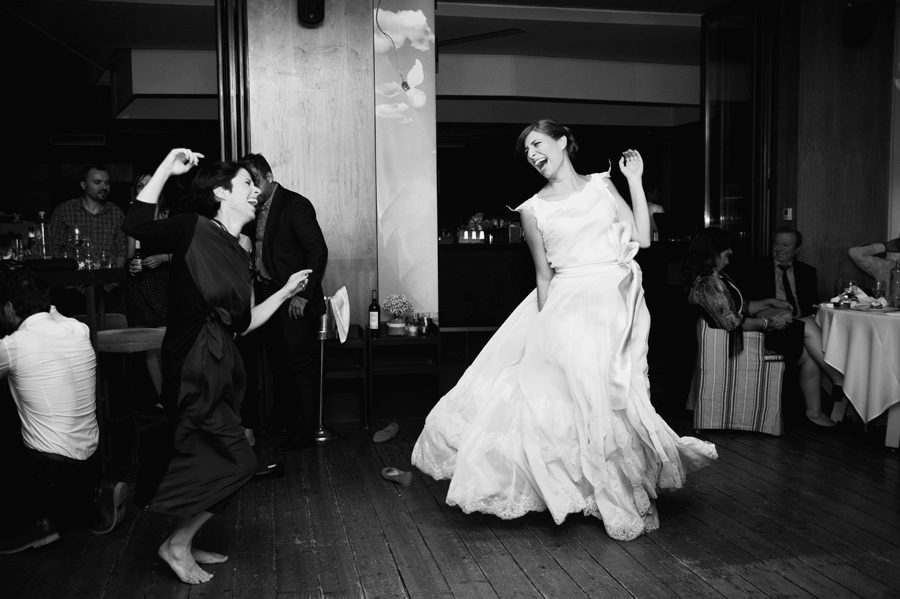 The bride is dancing with her best friend in the wedding party.Civil wedding in Thessaloniki,Greece