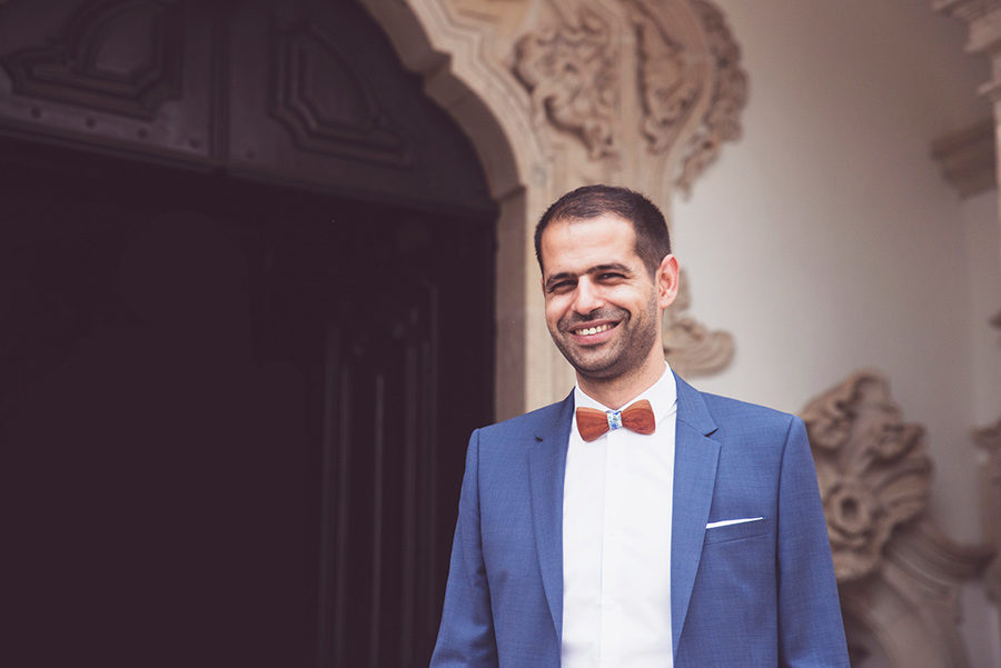 Groom smiles. He is waiting his love . Santuário de Nossa Senhora dos Remédios, Shrine of Our Lady of Remedies the cathedral in Lamego.Portugal. Layer Photography. Alepa Katerina