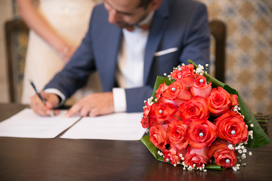 Signing the wedding papers. wedding flowers. Santuário de Nossa Senhora dos Remédios, Shrine of Our Lady of Remedies the cathedral in Lamego.Portugal. Layer Photography. Alepa Katerina