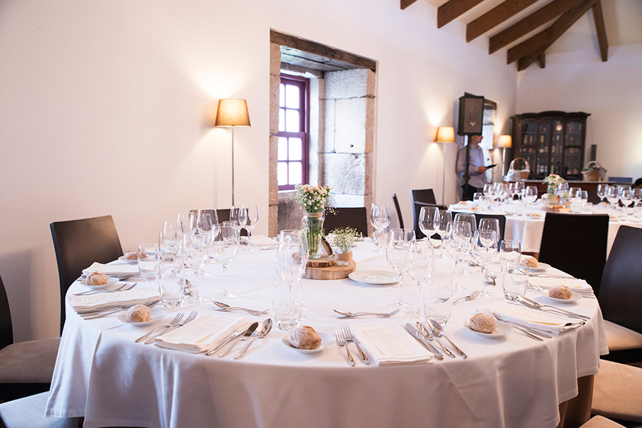 The table is ready. flowers. wine glasses. lights. glamour and chic. arte della table. Wood, glass. Bride and Groom. Wedding dinner.Quinta Vale De Locaia Lamego . Portugal . Layer Photography. Alepa Katerina